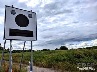 A Road Sign That Looks Like A Face in Cuna, Tuscany, Italy