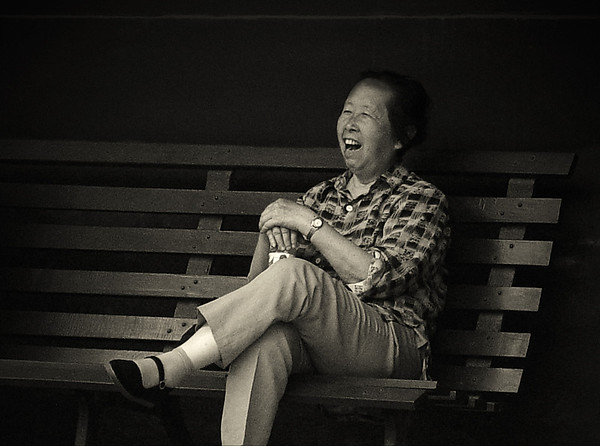 Woman on bench, Yonghe Gong Lamasery, Beijing