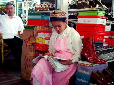 Schoolgirl studying Kashgar Indoor Bazaar DSC01930