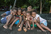 """Happy children on black sand beach, Ambryn Island, Vanuatu<br /> <br /> Ambryn Island is another of the islands in the archipelago of Vanuatu.  It contains a basaltic volcano with a large 12 km wide crater that is one of the most active volcanoes in the world.  The black sand beaches seen here come from the volcano.   It is famous for its Rom dance, the subject of an upcoming post.<br /> <br /> The women of Ambryn wear mumus, rather than traditional dress, a sign that missionaries have had some influence here.  They were also not as ready to smile as the people I encountered on other islands.  Indeed, my usual techniques to interact with the people I photograph didn't work very well here. Several photos of the women and children of Ambryn can be seen here: <a href=""""http://goo.gl/3dHHgd"""">http://goo.gl/3dHHgd</a><br /> <br /> 9/06/14  <a href=""""http://www.allenfotowild.com"""">http://www.allenfotowild.com</a>"""