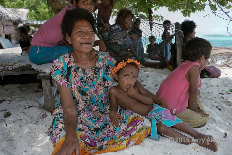 Women with children on the beach, Bodaluna Island, Laughlan Islands, Trobriand Islands
