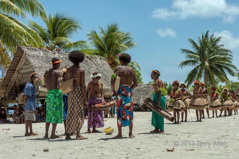 Villagers getting ready to dance, Bodaluna Island, Laughlan Islands, Papua New Guinea