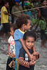 Indecision<br /> <br /> Three children, Bonarua Is, Brumer Islands, PNG<br /> <br /> These kids are so excited by the activities they just don't know where to look!  I like that one is looking left, the other right and the one in front is looking right at me.<br /> <br /> 45 mm, 1/60 sec, f 7.1, ISO 640, FF