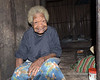 """Village elder, Bonarua Is, Brumer Islands, PNG<br /> <br /> It is hard to know how old this woman is, since the islanders seem to age much faster than us as they have very hard lives.<br /> <br /> Many of you have commented on how friendly the villagers seem, with wonderful smiles.  When we got to the island the people were very shy and tentative. I found one who spoke English and took some time to forget about taking photos and learn a few phrases of their language like 'Good Morning',  'Are You Well', Thank You Very Much' and 'May I Take Your Photo?', etc. The transformation was amazing.  People starting helping me with my pronunciation, and breaking up over my clumsy efforts, and were suddenly open and friendly.  The result was the brilliant smiles you see, and the direct engagement with the camera.<br /> <br /> Other photos from this location can be seen here <a href=""""http://goo.gl/IQrCM"""">http://goo.gl/IQrCM</a><br /> <br /> 24 mm, 1/60 sec,  f/7.1,  ISO 640, FF"""