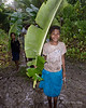 Girl with banana leaf umbrella, Fergusson Is, D'Entrecasteaux Island, PNG