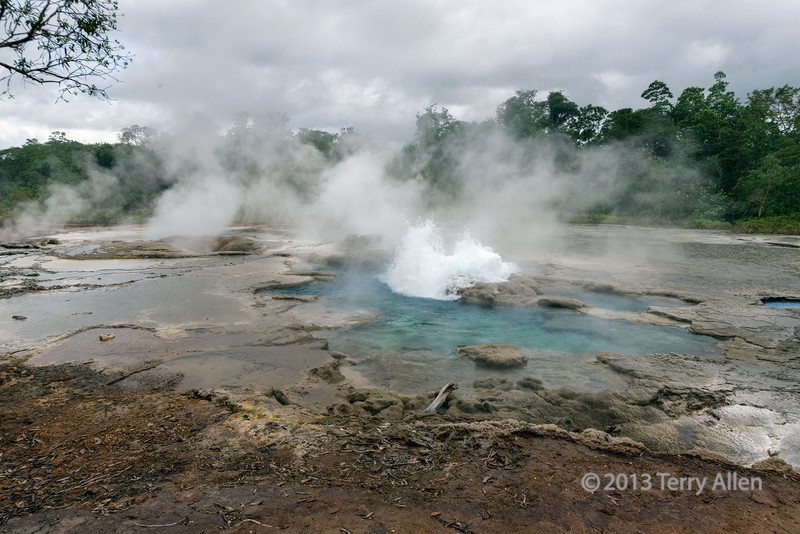 Hot springs with small geyser, Fergusson Is, D'Entrecasteaux Islands, PNG