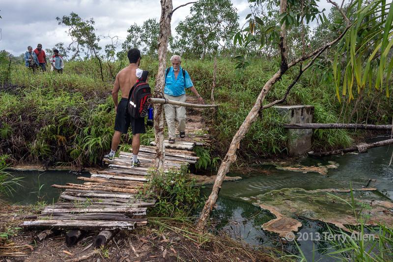 Bridge across hot stream, Fergusson Is, D'Entrecasteaux Island, PNG