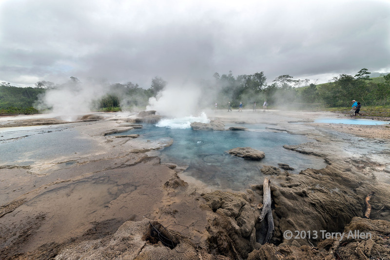 Large hot spring with geyser, Fergusson Is, D'Entrecasteaux Island, PNG<br /> <br /> This was a geyser that went off at random intervals, with anywhere from small to large eruptions that lasted only a second or two, so you had to be quick to catch one.