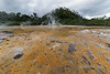 Sulfur and pebbles at hot springs, Fergusson Is, D'Entrecasteaux Island, PNG
