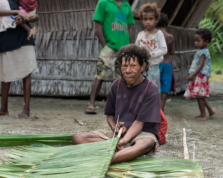 Man weaving mat, Dobu Island, D'Entrecasteaux Islands, PNG