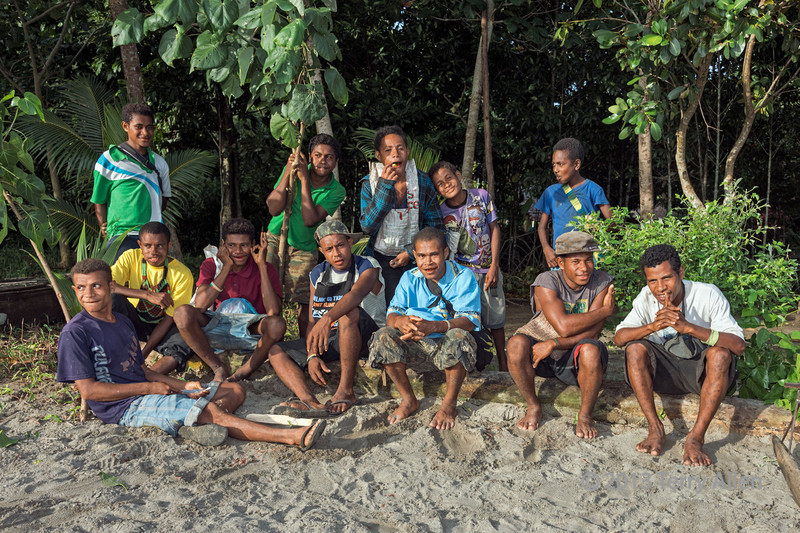 Young men hamming it up by the beach, Dobu Island, D'Entrecasteaux Islands, PNG