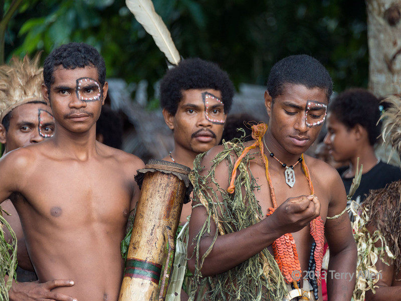 Warriors resting before performance, Dobu Island, D'Entrecasteaux Islands, PNG