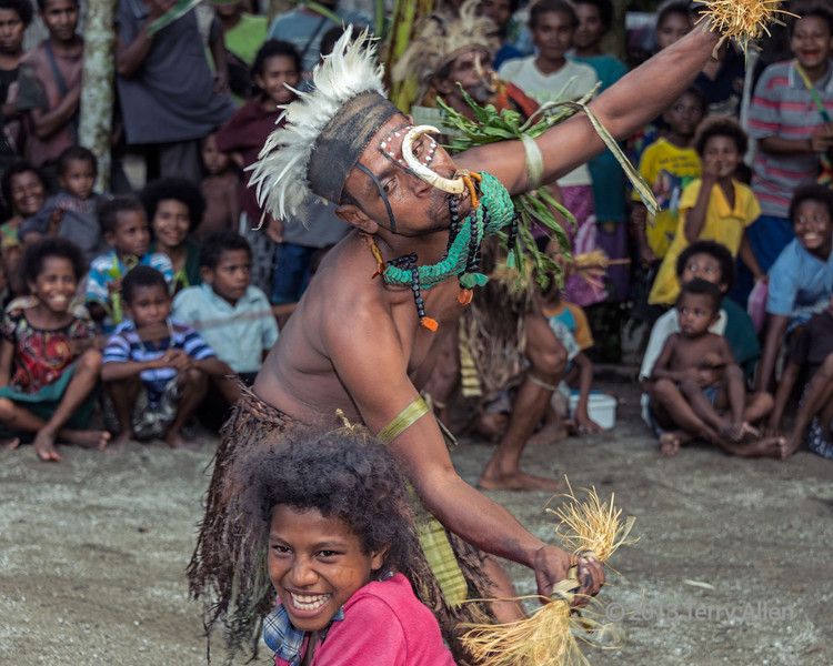 """Warrior dance where local girls are 'kidnapped', Dobu Is, D'Entrecasteaux Islands, PNG<br /> <br /> Sorry, my day got away from me (I was triple booked!), so not much time left for comments!<br /> <br /> See more photos from Dobu Island here: <a href=""""http://goo.gl/XU5VS"""">http://goo.gl/XU5VS</a><br /> <br /> According to the anthropologist, Nancy Sullivan: """"Relations between men and women were managed almost entirely by magic. Without a love charm to arouse and create desire, desire does not exist to the Dobuan. Men and women mate, he (Reo Fortune) reported, only because men are constantly exerting magical power over women, and women over men. But this custom made men and women wildly jealous of each other. If their own natural charms were not enough to draw and hold a mate, then they were constantly searching for and testing out counter-magic to deflect competitors and win over the wayward affections of their mate. Needless to say, the pursuit of happiness was anything but peaceful. It created malicious rivalries with suspicions of poisoning and even death between rivals, lovers, spouses and their families.<br /> <br /> 82 mm, 1/100 sec, f 6.3, ISO 640, flash fill"""