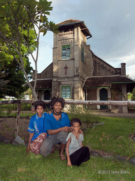 Family in front of Bromilow Memorial, Dobu Island, D'Entrecasteaux Islands, PNG<br /> <br /> Bromilow was the anthropologist who first described the culture of Dobu Island in 1930.