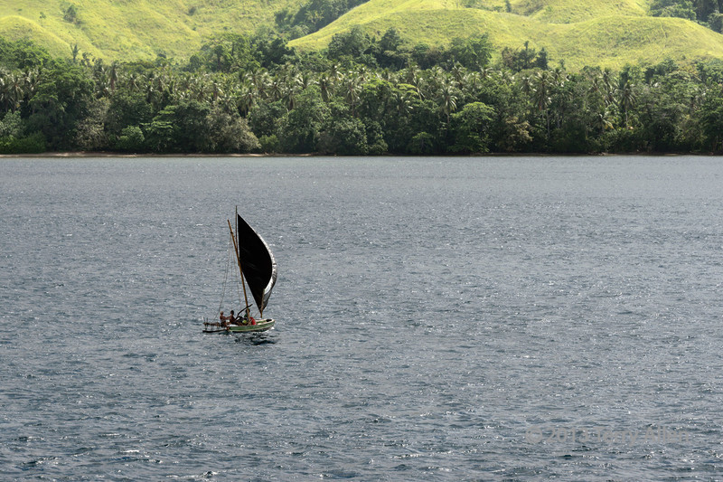 Outrigger-sailing-off-Normanby-Is-3,-D'Entrecasteaux-Islands,-PNG