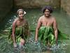Banks Island women making water music-4, Nekar Village, Luganville, Espiritu Santo Is, Vanuatu