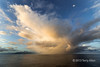 Rainstorm at sunrise with moon over Guadalcanal Is, Solomon Islands<br /> <br /> This rainstorm was followed by the rainbow seen in the accompanying image posted today.