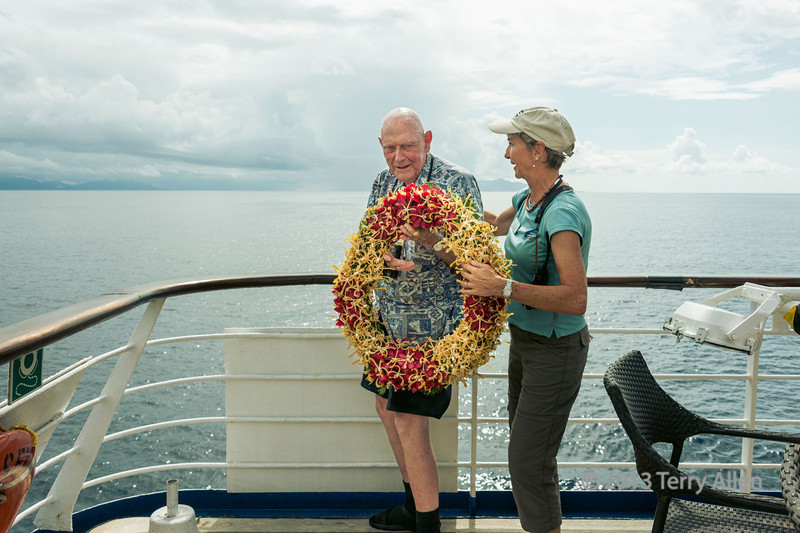 """WWII vet with wreath, Iron Bottom Sound, Guadalcanal Is, Solomon Islands<br /> <br /> Every year on the battle's anniversary, a US ship in the area cruises into the waters and drops a wreath to commemorate those who lost their lives in Iron Bottom Sound. For many Navy sailors, and those who served in the area during that time, the waters in this area are considered sacred, and strict silence is observed as ships cruise through.<br /> <br /> The fascinating story of the Battle of Guadalcanal First Naval Battle of Ironbottom Sound can be read here: <a href=""""http://www.historynet.com/battle-of-guadalcanal-first-naval-battle-in-the-ironbottom-sound.htm"""">http://www.historynet.com/battle-of-guadalcanal-first-naval-battle-in-the-ironbottom-sound.htm</a>"""