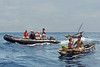Zodiac and outriggers, Kitava Island, Trobriand Islands, PNG