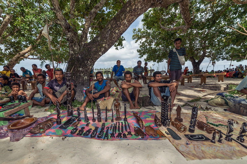 Carvers with their artifacts, Kitava Island, Trobriand Islands, PNG