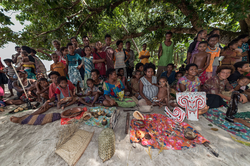 Villagers selling artifacts, Kitava Island, Trobriand Islands, PNG