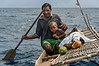 Islander and son on outrigger canoe-2, Kitava Island, Trobriand Islands, PNG