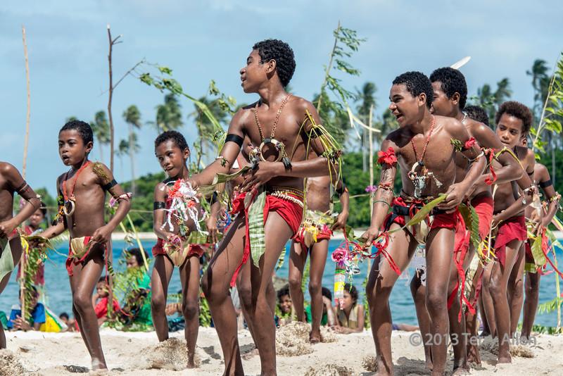 Boys doing 'cricket' dance, Kitava Island, Trobriand Islands, PNG