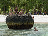 Boys playing on a hunk of coral-2, Kitava Island, Trobriand Islands, PNG