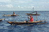 Islanders in outrigger canoes-2, Kitava Island, Trobriand Islands, PNG