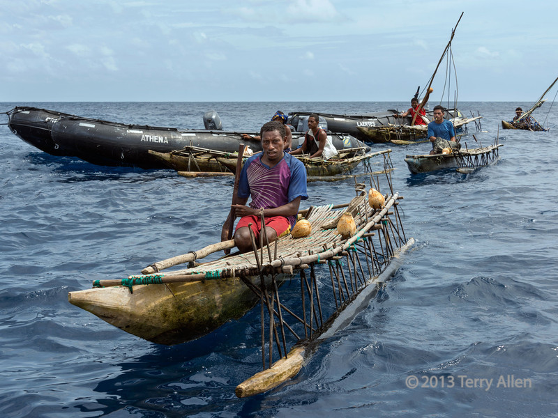 Islander in outrigger canoes, Kitava Island, Trobriand Islands, PNG
