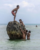 Boys-playing-on-hunk-of-coral,-Kitava-Is,-Trobriand-Islands,-PNG