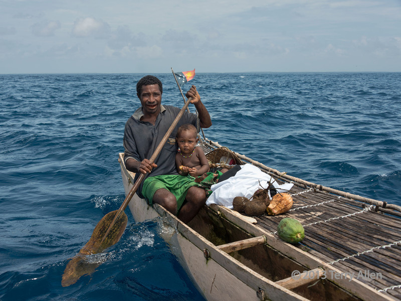 Islander and son on outrigger canoe, Kitava Island, Trobriand Islands, PNG