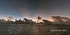 Sunrise, God's rays and rainstorms near Santa Ana Is, Solomon Islands