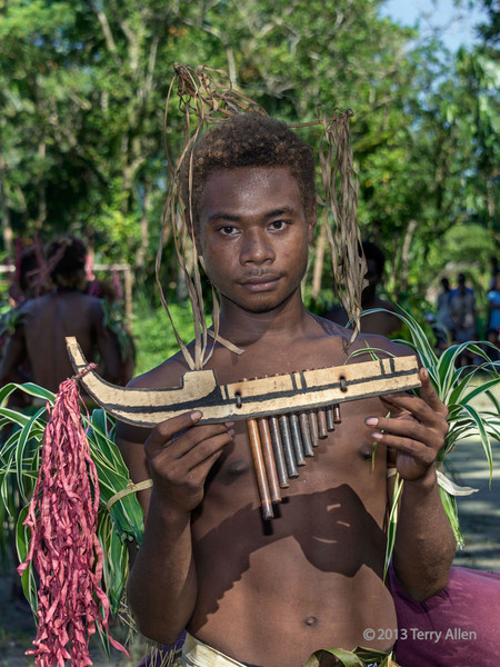 Portrait of a pan pipe player, Santa Ana Island, Solomon Islands