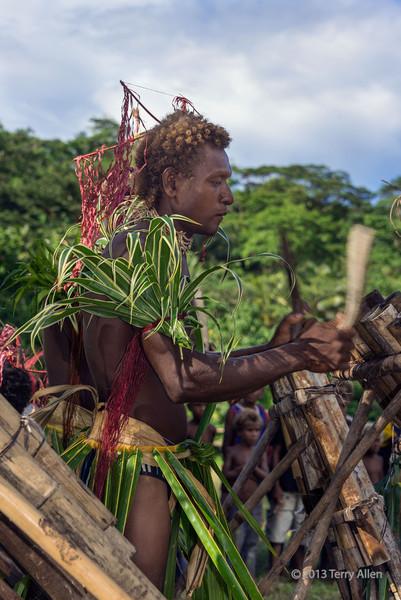Making bamboo music, Santa Ana Island, Solomon Islands