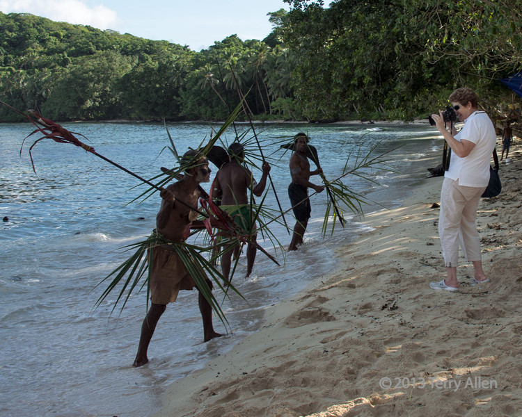 Photograher under 'attack', Santa Ana Is, Solomon Islands