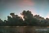 Sunrise and rainstorms-1 near Santa Ana Is, Solomon Islands