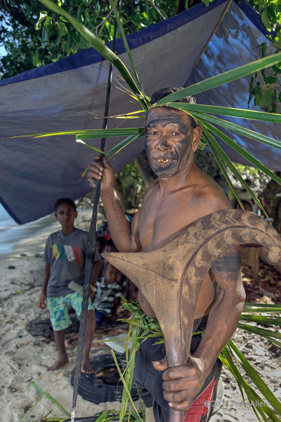 Portait of a warrior carrying spear and wooden parrying shield #6, Santa Ana Island, Solomon Islands