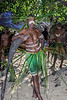 Portrait of a warrior leaning on wooden parrying shield #5, Santa Ana Island, Solomon Islands