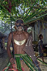 "Portait of a warrior-7, Santa Ana Island in the <br /> Santa Cruz Islands, Solomon Islands<br /> <br /> This warrior is wearing a pearl shell Dafi or Tema (means chest ornament) with frigate bird overlay. Dafi shell jewelry is similar to kina shell jewelry in New Guinea.  He is carrying a wooden parrying shield with a carved fish (probably hound needlefish) on it<br /> <br /> Other warrior portraits can be seen here: <a href=""http://goo.gl/nAQ5j3"">http://goo.gl/nAQ5j3</a><br /> <br /> 9/12/13  <a href=""http://www.allenfotowild.com"">http://www.allenfotowild.com</a>"