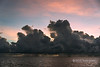 "Sunrise and rainstorms #2 near Santa Ana Is, Solomon Islands<br /> <br /> On board ship I always was up before sunrise to do my yoga and photograph the dramatic tropical skies.  At the largest sizes you can see several rainstorms along the horizon between the clear areas.<br /> <br /> Other photos of these dramatic rainstorms, and a double rainbow, can be seen here: <a href=""http://goo.gl/Sa2D0J"">http://goo.gl/Sa2D0J</a><br /> <br /> 7/12/13  <a href=""http://www.allenfotowild.com"">http://www.allenfotowild.com</a>"