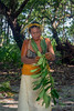 Woman wearing tapa cloth skirt and terenghe (tumeric) getting ready for dance, Tikopia Island, Solomon Islands