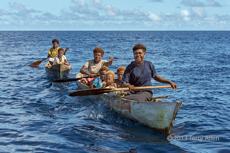 Women and children in dugout canoes, Utupua Is, Solomon Islands