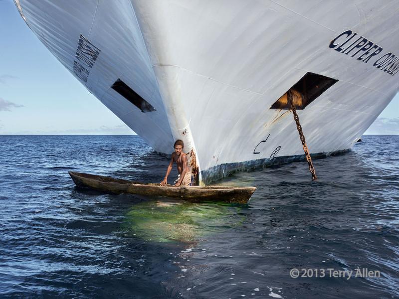 Large ship, small boy with dugout canoe-1, Utupua Is, Solomon Islands