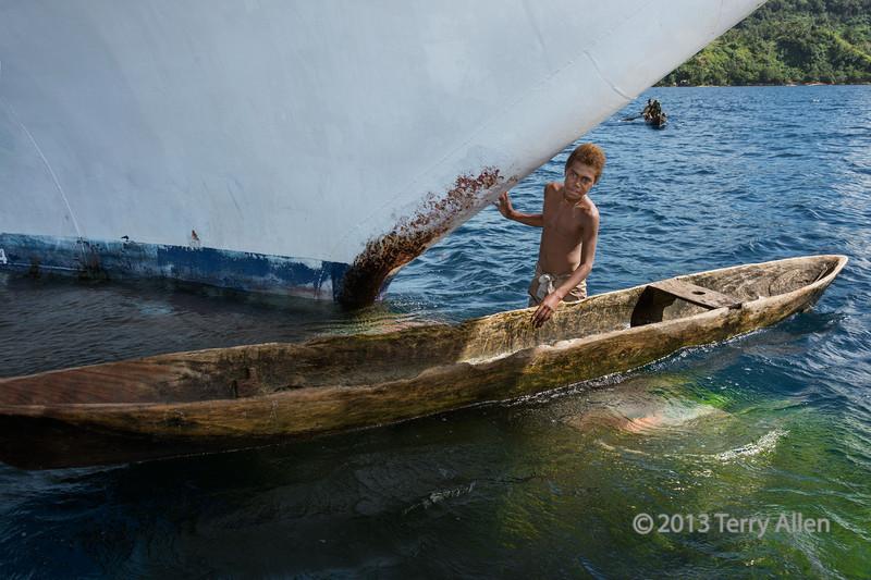 Large ship, small boy with dugout canoe-2, Utupua Is, Solomon Islands