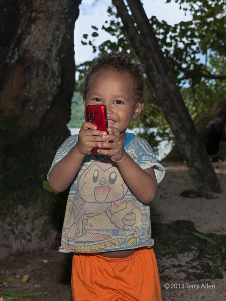 Baby with prized possession, Utupua Is, Solomon Islands