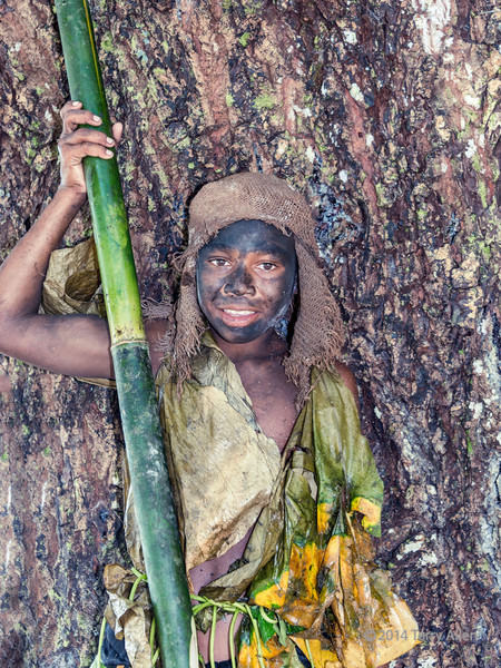 """Portrait of a young 'warrior', Utupua Island, Solomon Islands<br /> <br /> When I saw this young boy in his outfit made from vines, leaves and other natural materials, I posed him against a large tree to complete the picture of a 'wild child'.<br /> <br /> Other photos of the beautiful local children can be seen here: <a href=""""http://goo.gl/v9lCQL"""">http://goo.gl/v9lCQL</a><br /> <br /> 2/1/14   <a href=""""http://www.allenfotowild.com"""">http://www.allenfotowild.com</a>"""