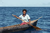 Woman paddling dugout canoe, Utupua Is, Solomon Islands