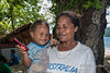 Village nurse and baby with cell phone, Utupua Island, Solomon Islands