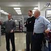Joe Thompson, president of ROUSH CleanTech, leads customer tour through ROUSH CleanTech's manufacturing facility.